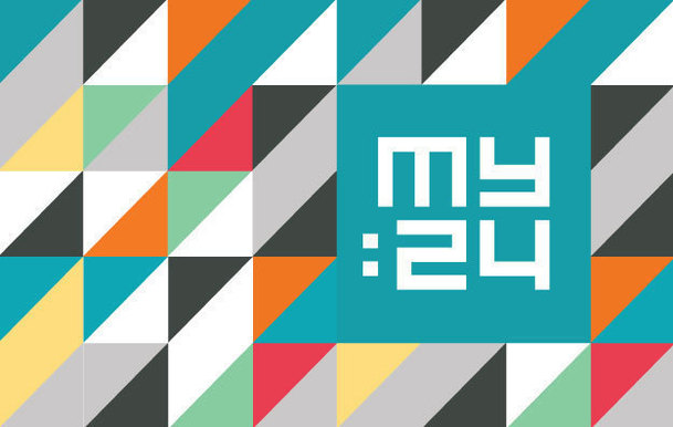 My:24 on a coloured geometric background