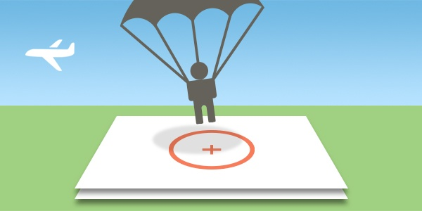 Illustration of a person parachuting, about to land on a marker.